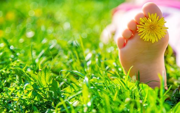 Child feet on the grass