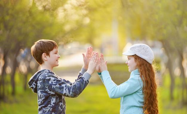 Child friend enjoying clapping hands