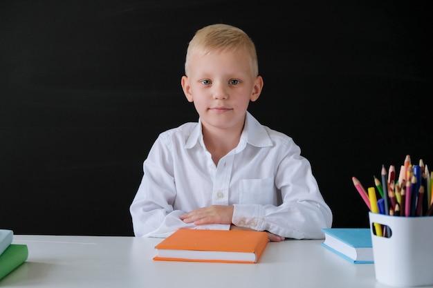 Child from elementary school at blackboard