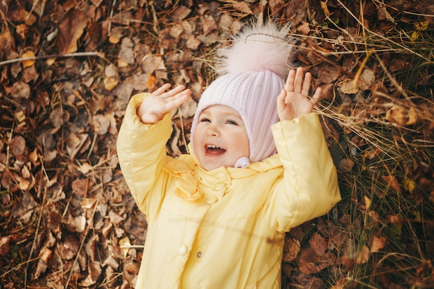 Child funs in the woods. autumn park. the concept of fashion, accessories, outdoor walks