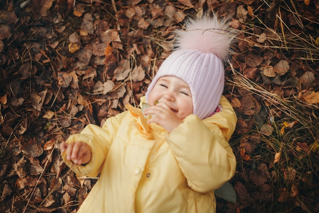 Child funs in the woods. autumn park.  fashion, accessories, outdoor walks