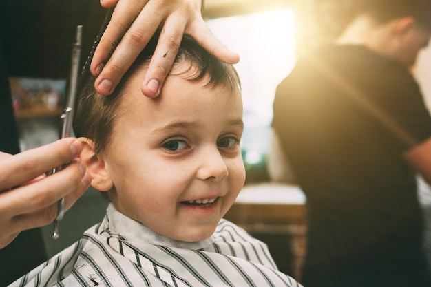 Child getting his haircut at the barbershop