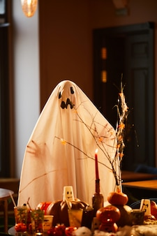 Child in ghost costume on halloween