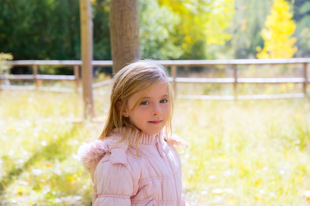 Child girl in autumn outdoor nature landscape