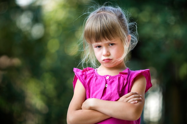 Child girl feeling angry and unsatisfied