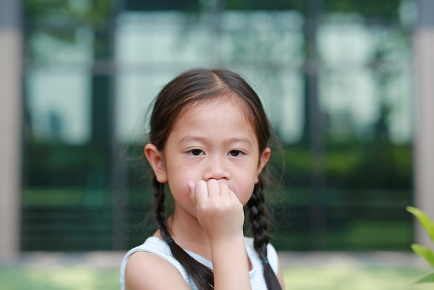 Child girl intend sucking her fingers