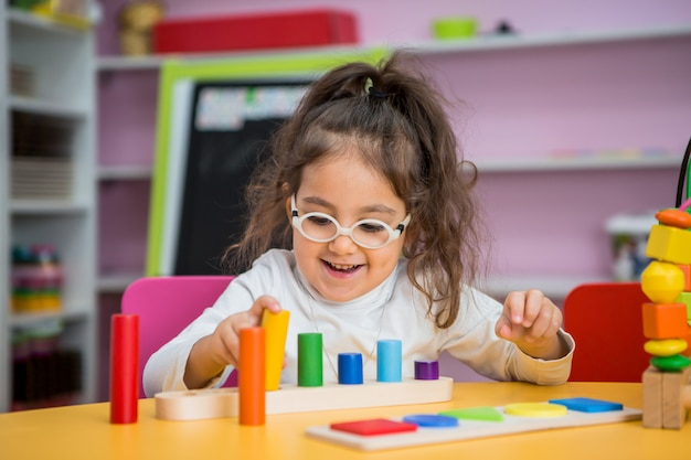 Child girl  plays in educational classes