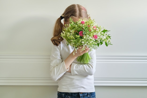 Child girl with bouquet of beautiful spring flowers