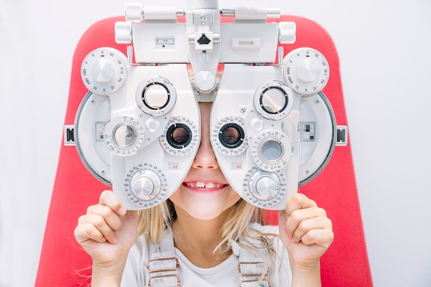 Child girl with an ophthalmologic device