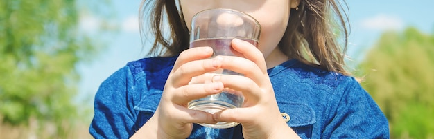 Child glass of water. selective focus. nature.