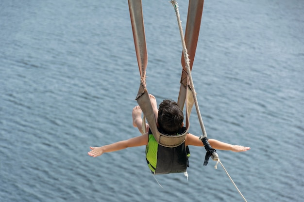 Child going down with the zip line in the jacoma lagoon in brazil.