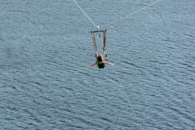 Child going down with the zip line.