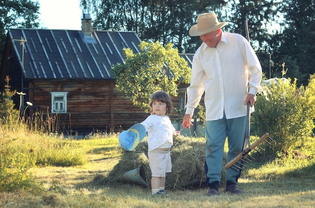 Child and grandfather rural field