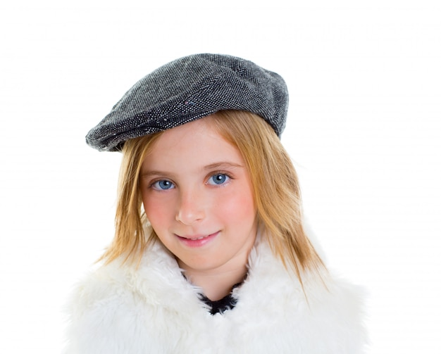 Child happy blond kid girl portrait winter cap smiling