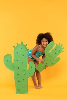 Child having fun in a summer setting studio