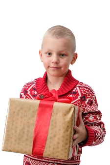 Child holding christmas gift box in hand. isolated on white background. holidays, christmas, new year, x-mas concept.