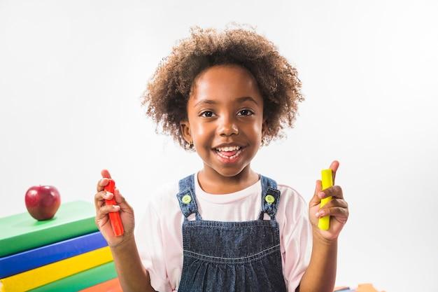 Child holding plasticine in studio