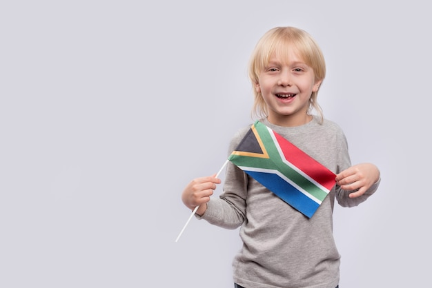 Child holding the south africa flag