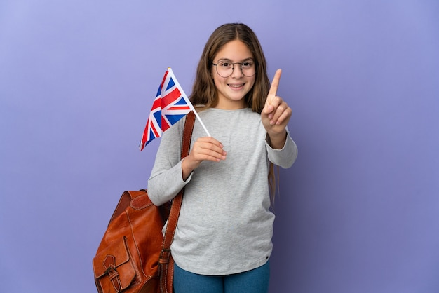 Child holding an united kingdom flag over isolated background showing and lifting a finger
