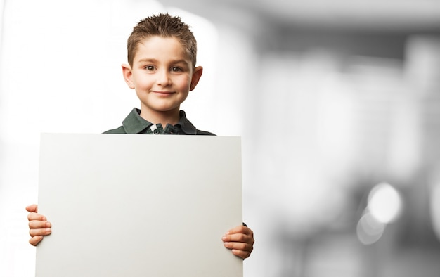 Child holding a white poster