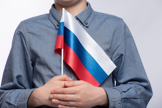 Child holds russian flag close up