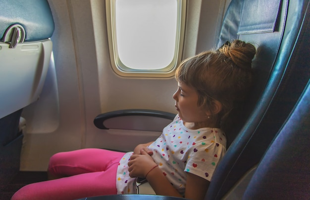 The child is sleeping on the plane