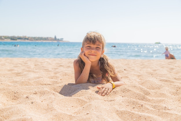 The child is swimming in the sea. selective focus. kid.
