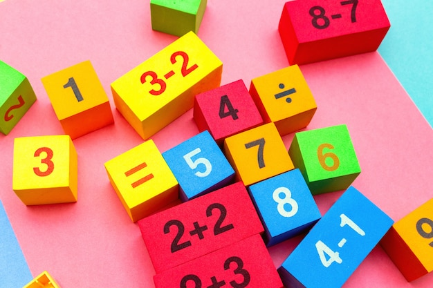 Child kid colorful education toys cubes with numbers. flat lay. childhood infancy children babies concept.