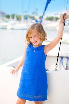 Child kid girl in marina boat on summer vacations