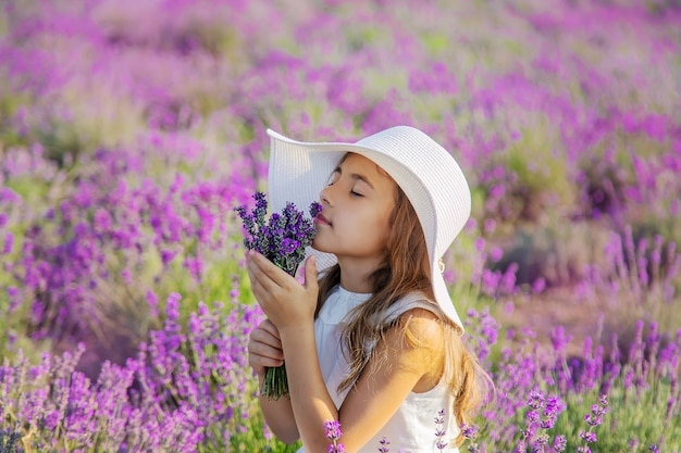 A child in a lavender field. selective focus. nature.