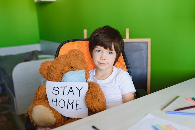Child learning and writing coronavirus