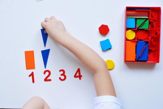The child learns number line and geometric shapes. the preschooler works with montessori material.