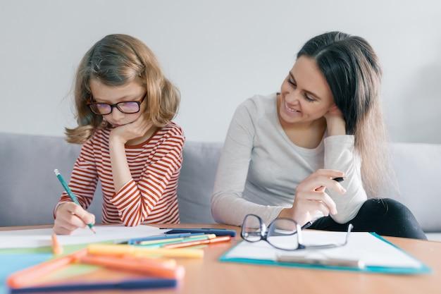 Child learns with a teacher
