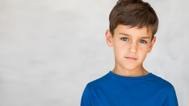 Child looking serious with copy space