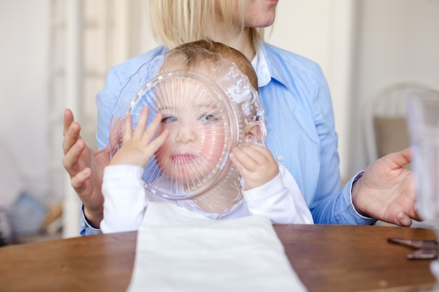 Child looking through glass plate