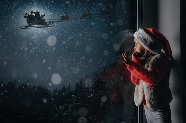 The child looks out the window on christmas of jesus christ