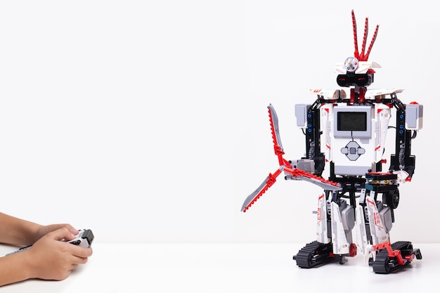 Child makes a robot with random pieces