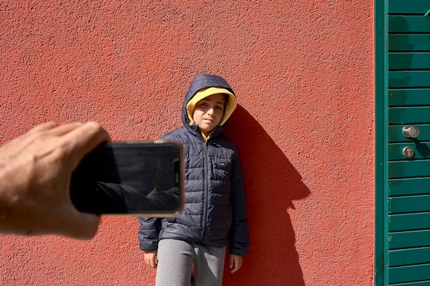 Child making a photo at his friend