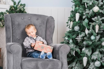 Child on couch with present
