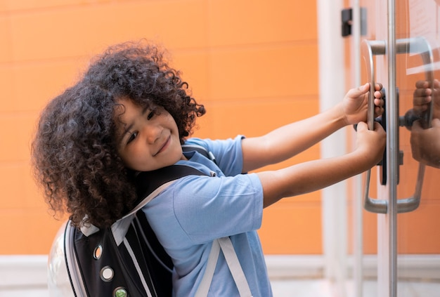 Child opens school door, angry is late, back to school, preschool