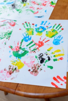 Child painting by his hands
