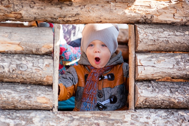 A child in the park played in the wooden house