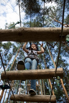 Child passes through a section of the rope park