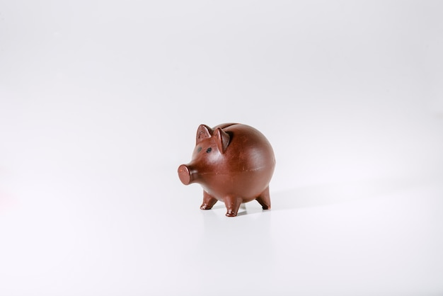 Child piggy bank isolated on white where to save coins.