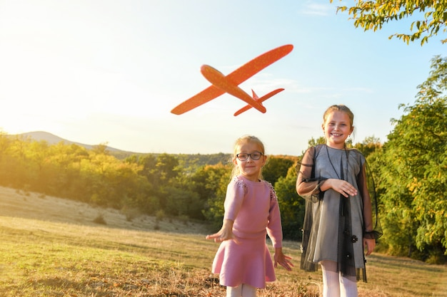 Child pilot aviator with airplane dreams of traveling in summer