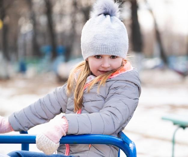 Child plating at playground toys