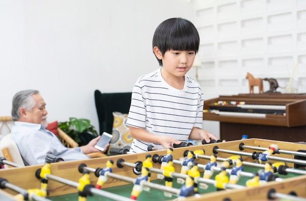 Child play football game board at home.