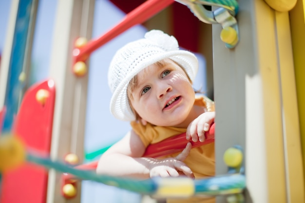 Child at playground area in summer