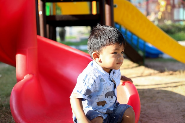 Child playing on outdoor playground.