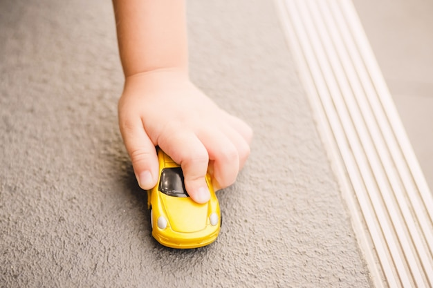 Child playing the toy car